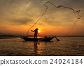 Silhouette of traditional fishermen 24924184