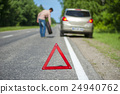 Male driver with spare wheel after breakdown 24940762
