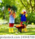 Kids picking vegetables on organic farm 24948788