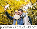 Beautiful young couple taking selfie in autumn 24949725