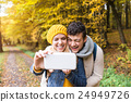 Beautiful young couple taking selfie in autumn 24949726