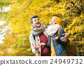 Beautiful couple on a walk in autumn forest 24949732