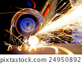 Worker cutting metal with grinder 24950892