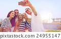 happy friends taking selfie by smartphone in tokyo 24955147
