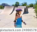 Girl riding on roller skates in skatepark. Outdoor 24966578