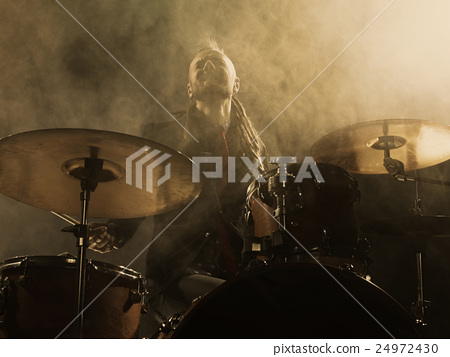 Silhouette drummer on stage. 24972430
