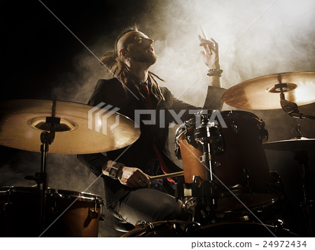 Silhouette drummer on stage. 24972434