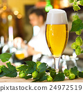 Beer glass and hops in the pub 24972519