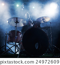 Silhouette of the drummer on stage. 24972609