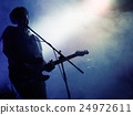 Silhouette of guitar player on stage. 24972611