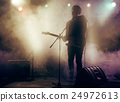Silhouette of guitar player on stage. 24972613