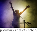 Silhouette of guitar player on stage. 24972615