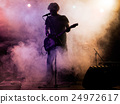 Silhouette of guitar player on stage. 24972617