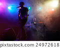 Silhouette of guitar player on stage. 24972618
