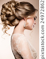 Beautiful bride with fashion wedding hairstyle - 24972862