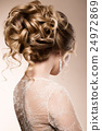 Beautiful bride with fashion wedding hairstyle - 24972869