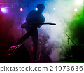 Silhouette of guitar player on stage. 24973636