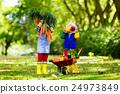 Kids picking vegetables on organic farm 24973849