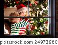 Kids decorating Christmas tree 24973960