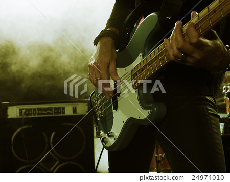 Bassist in the foreground. 24974010