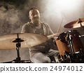 Silhouette of the drummer on stage. 24974012