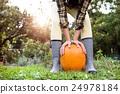 Unrecognizable woman in striped rubber boots 24978184