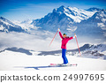 Young woman skiing in the mountains. 24997695