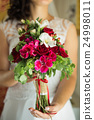 Wedding bouquet in hands 24998011