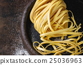 Raw homemade pasta tagliatelle 25036963