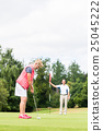 Senior woman practicing with golf pro 25045222