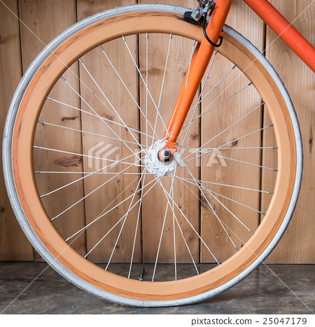 fixed gear bicycle parked with wood wall 25047179