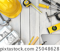 Construction tools on a wooden background.  25048628