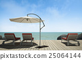 daybed with umbrella on  wooden terrace at sea vie 25064144