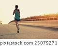 young woman runner running on city bridge road 25079271