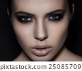 Beautiful woman model smokey eyes makeup closeup 25085709
