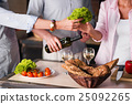 People cooking together healthy food in the 25092265