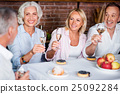 Beautiful mature family toasting with white wine 25092284