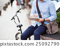Pleasant man sitting in the street 25092790