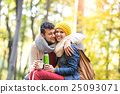 Beautiful couple in autumn forest, thermos and cup 25093071