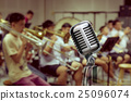 Retro Microphone over Abstract blurred photo of classic music band when rehearsal, musical concept, seminar meeting concept 25096074