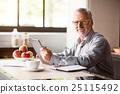 Portrait of happy senior man using laptop in 25115492