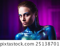 Portrait of beautiful woman painted with cosmic 25138701