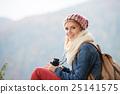Beautiful young woman holding binoculars, colorful 25141575