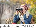 Beautiful woman looking through binoculars 25141576