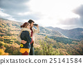 Young couple on a walk in sunny autumn forest 25141584