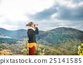 Beautiful woman looking through binoculars 25141585