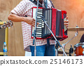 Close up musicians are playing accordion on stage 25146173