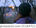 Girl looking at evening city lights 25164721