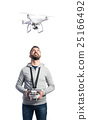 Man with flying drone. Studio shot on white 25166492