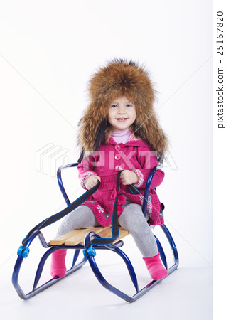 little girl with sled on white background 25167820